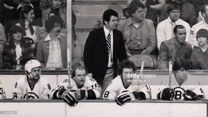 Harry Sinden behind the Bruins bench.