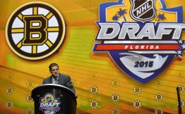 Jun 26, 2015; Sunrise, FL, USA; Boston Bruins general manager Don Sweeney makes the first of three consecutive draft picks in the first round of the 2015 NHL Draft at BB&T Center. Mandatory Credit: Steve Mitchell-USA TODAY Sports