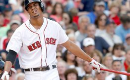 BOSTON, MA - JUNE 14:  Xander Bogaerts #2 of the Boston Red Sox reacts after he struck out with a man in scoring position against the Cleveland Indians in the fifth inning  at Fenway Park on June 14, 2014 in Boston, Massachusetts.  (Photo by Jim Rogash/Getty Images)